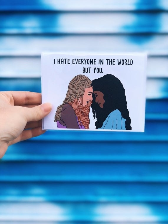 """A drawing of Rue and Jules from """"Euphoria"""" on a white card, with """"I hate everyone in the world but you"""" written in black above them"""