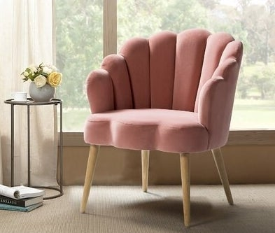 Velvet scalloped back chair with wooden legs
