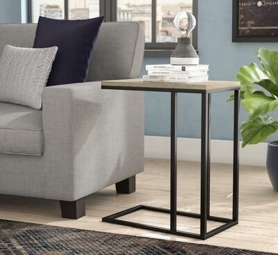 Metal frame side table with manufactured wooden top