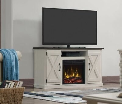 TV stand made of manufactured wood with two cabinets and fireplace