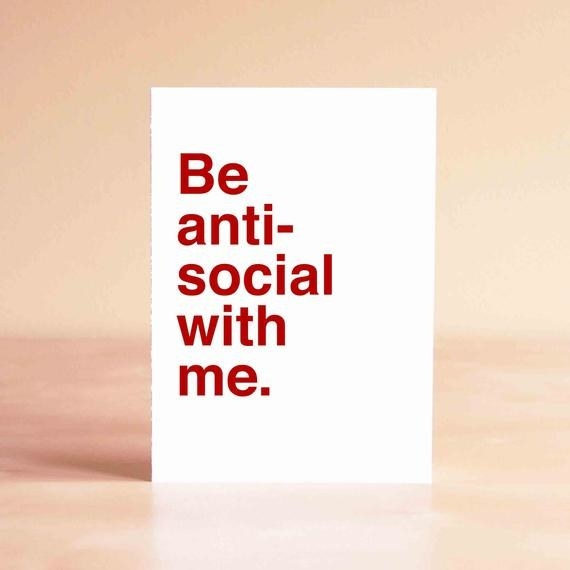 """A white card that says """"Be anti-social with me"""" in red type"""