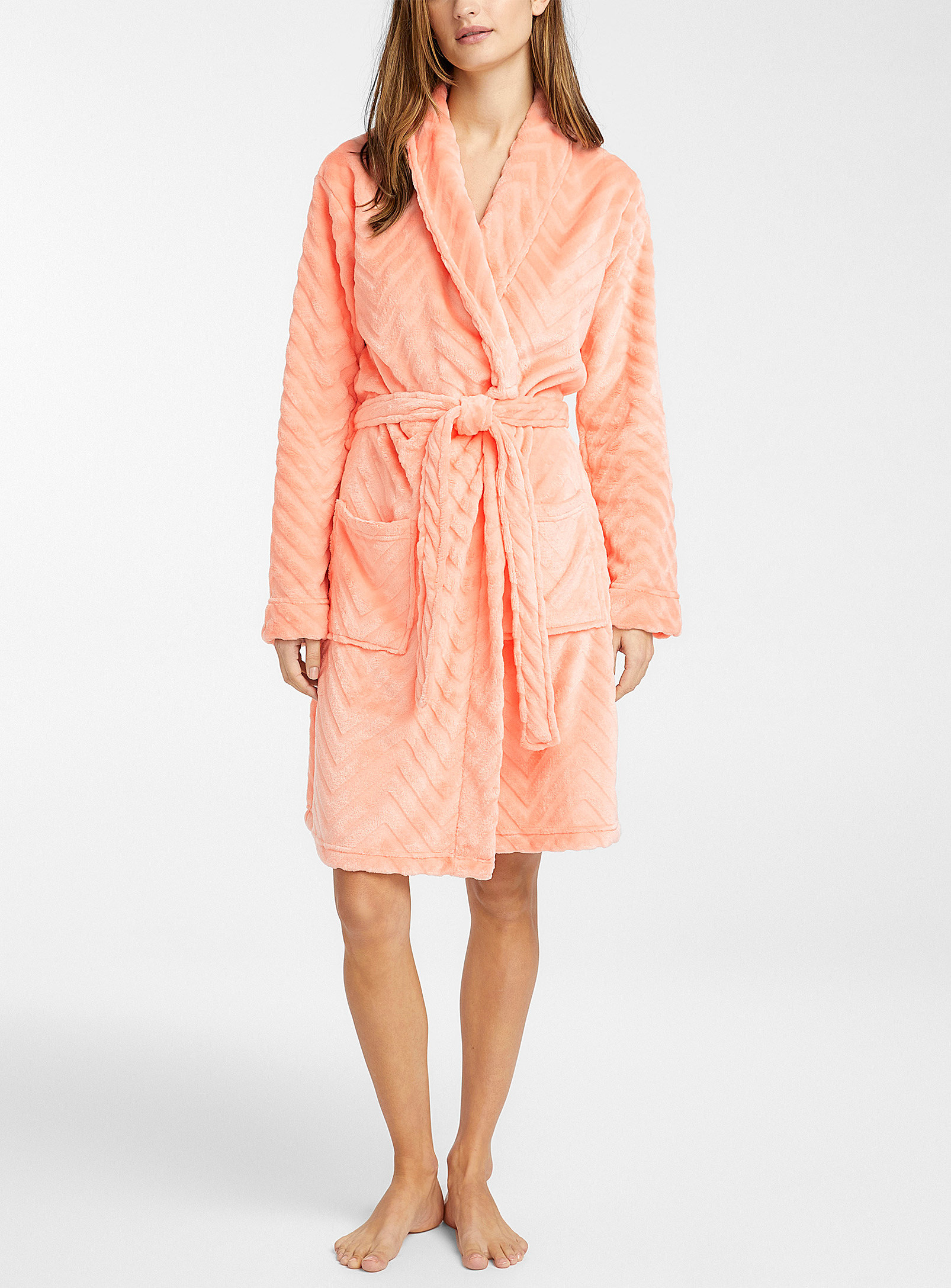 person standing in the bathrobe