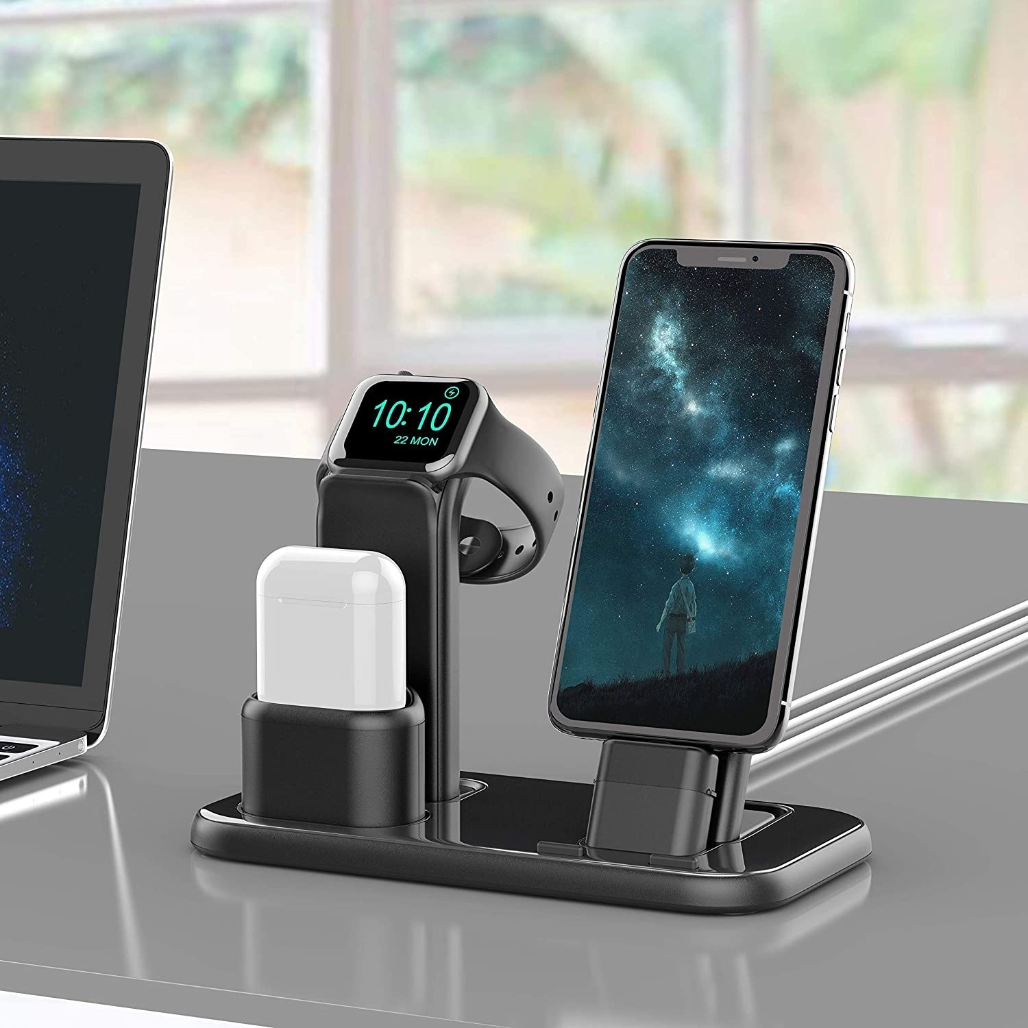 Black three in one charging station with white AirPods, black iPhone and black Apple watch