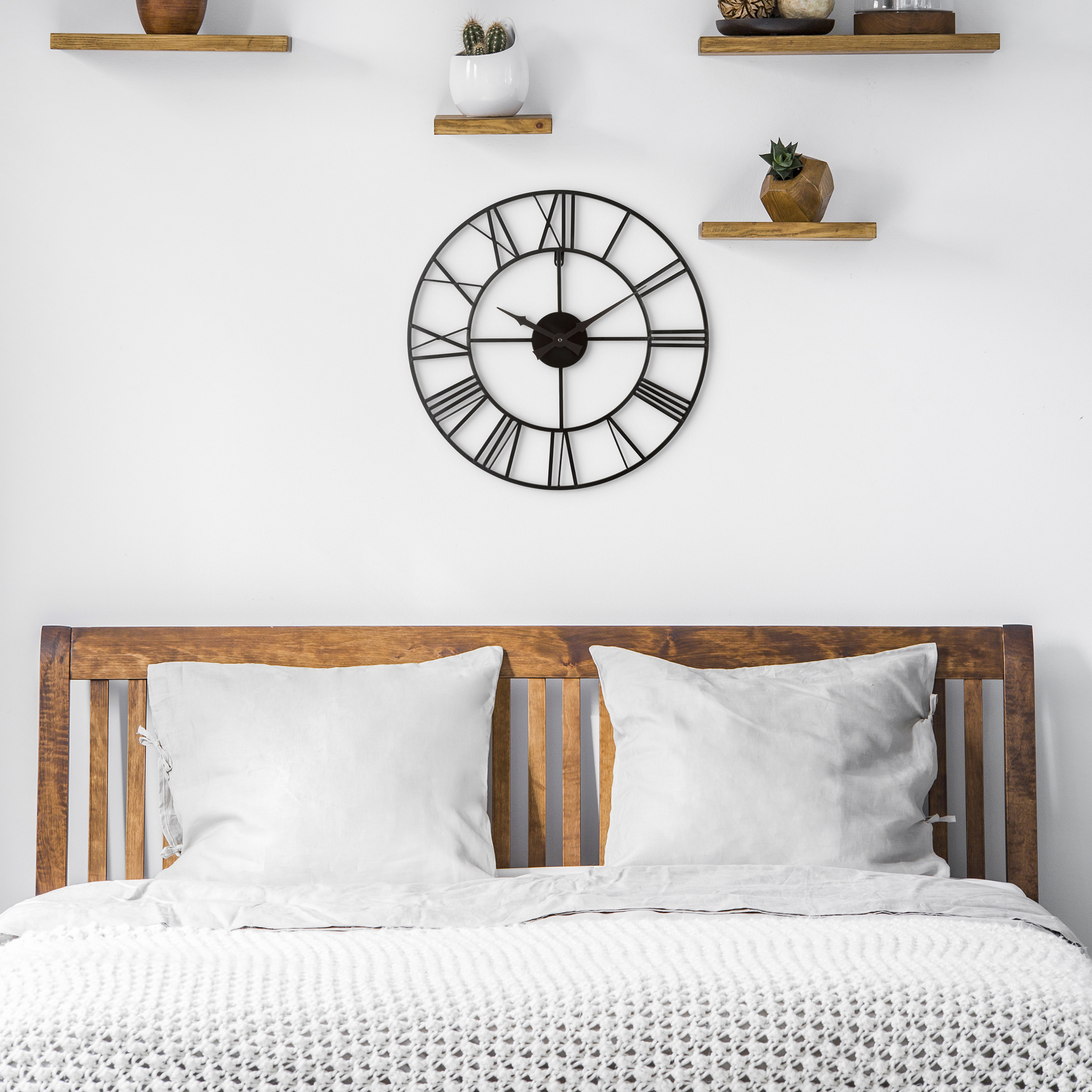 A bed with a clock above it