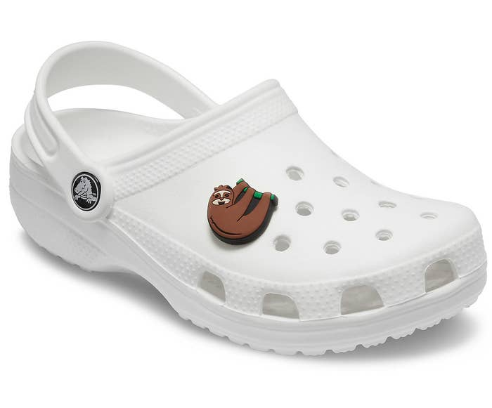 sloth charm attached to a white Croc shoe