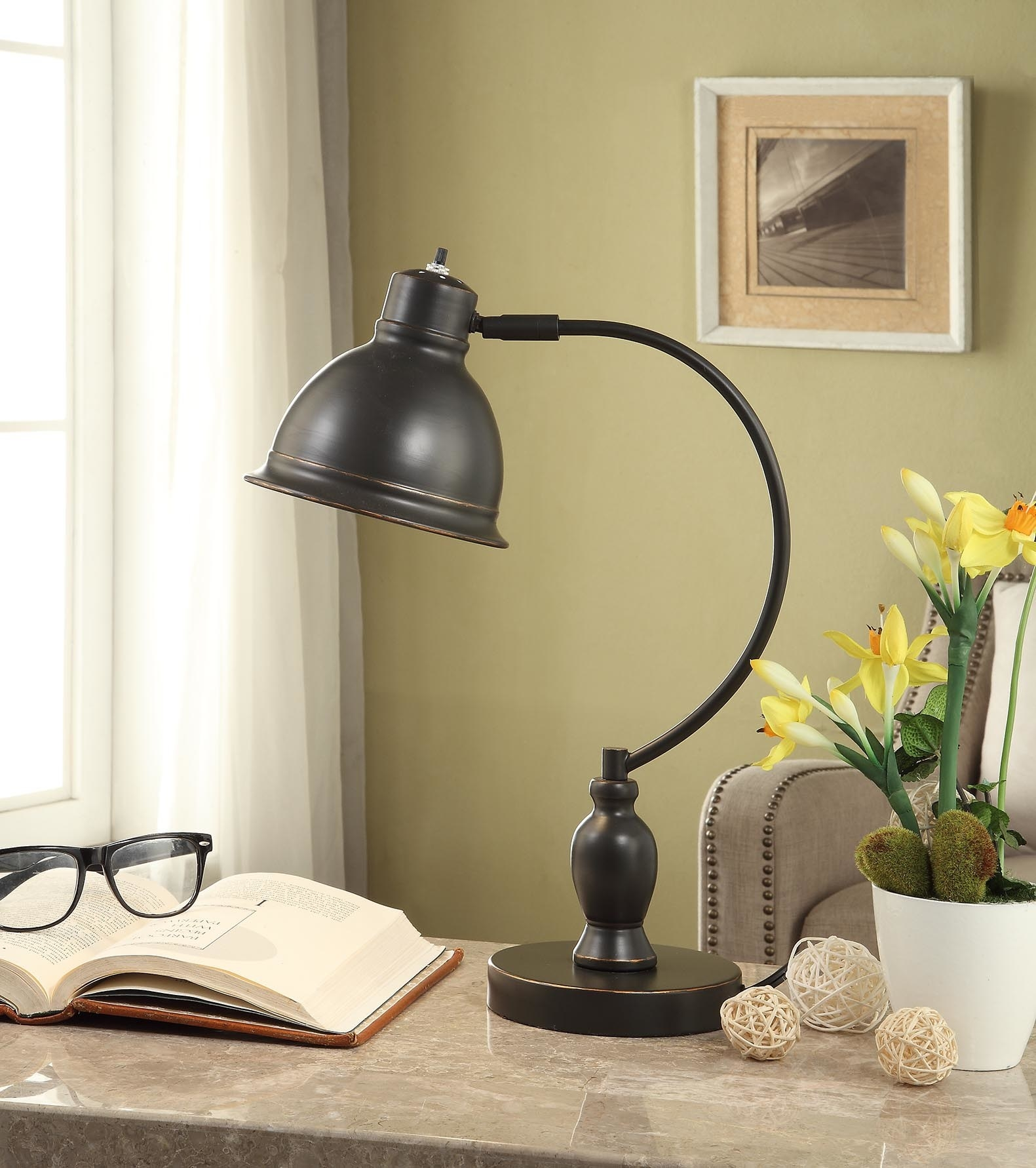 A traditional bronze light at a desk
