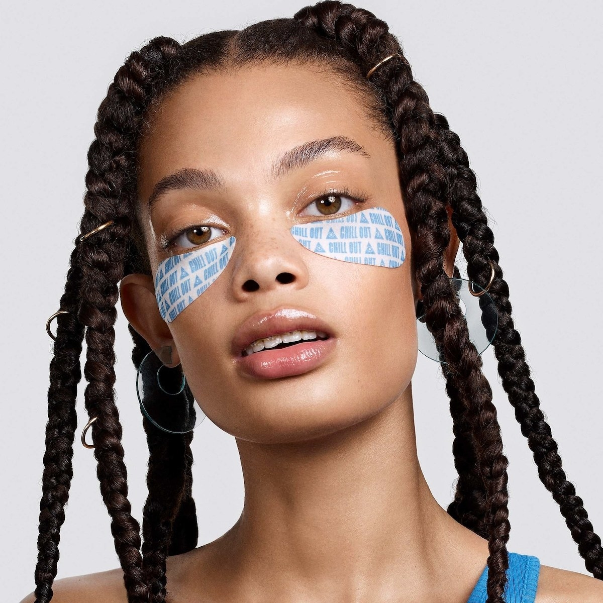 model wearing blue eye patches