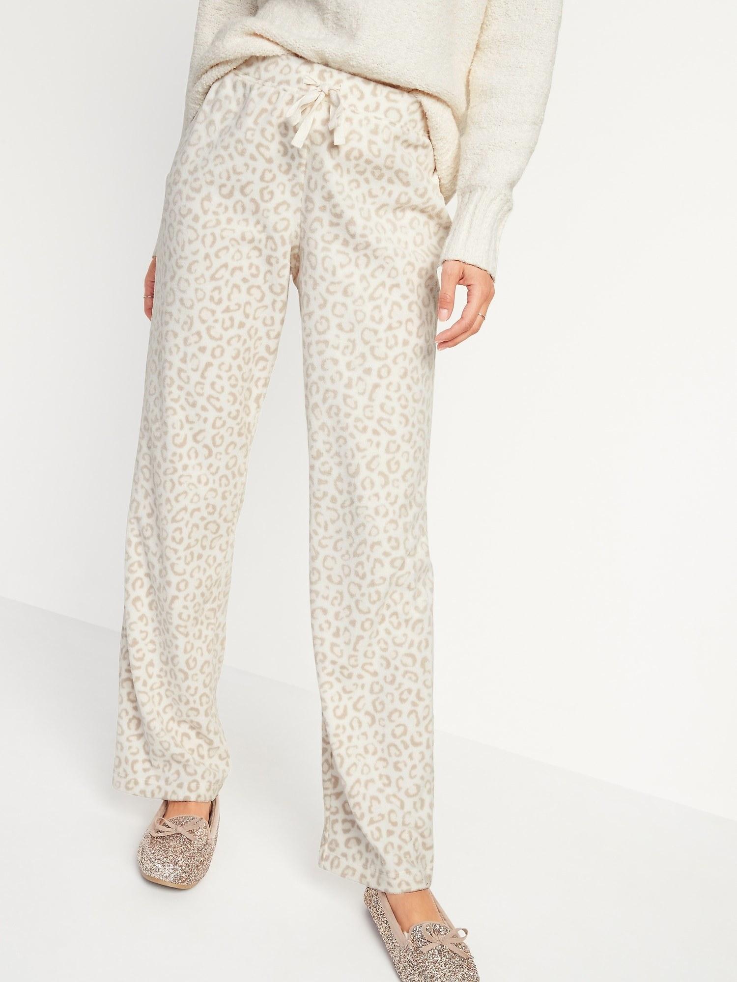 model wearing pajama pants in leopard