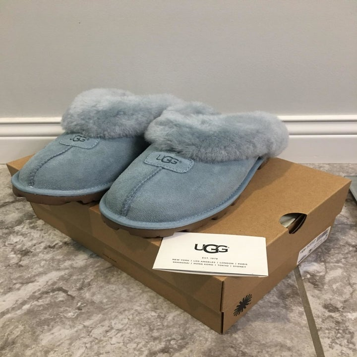 Reviewer pic of grey slippers with fuzzy insides