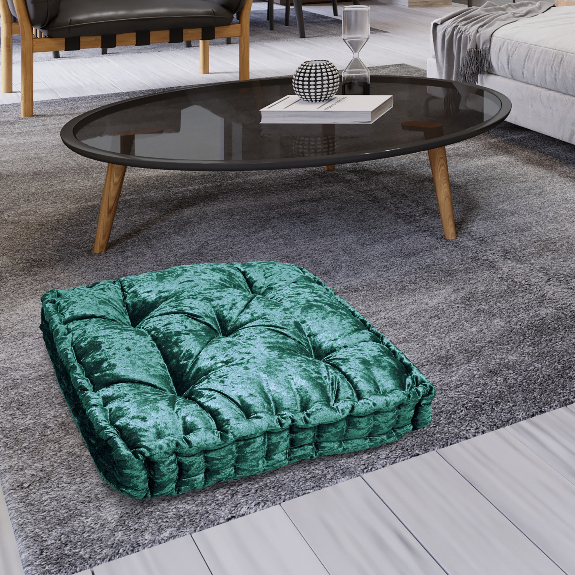 A green floor cushion on a floor in a home