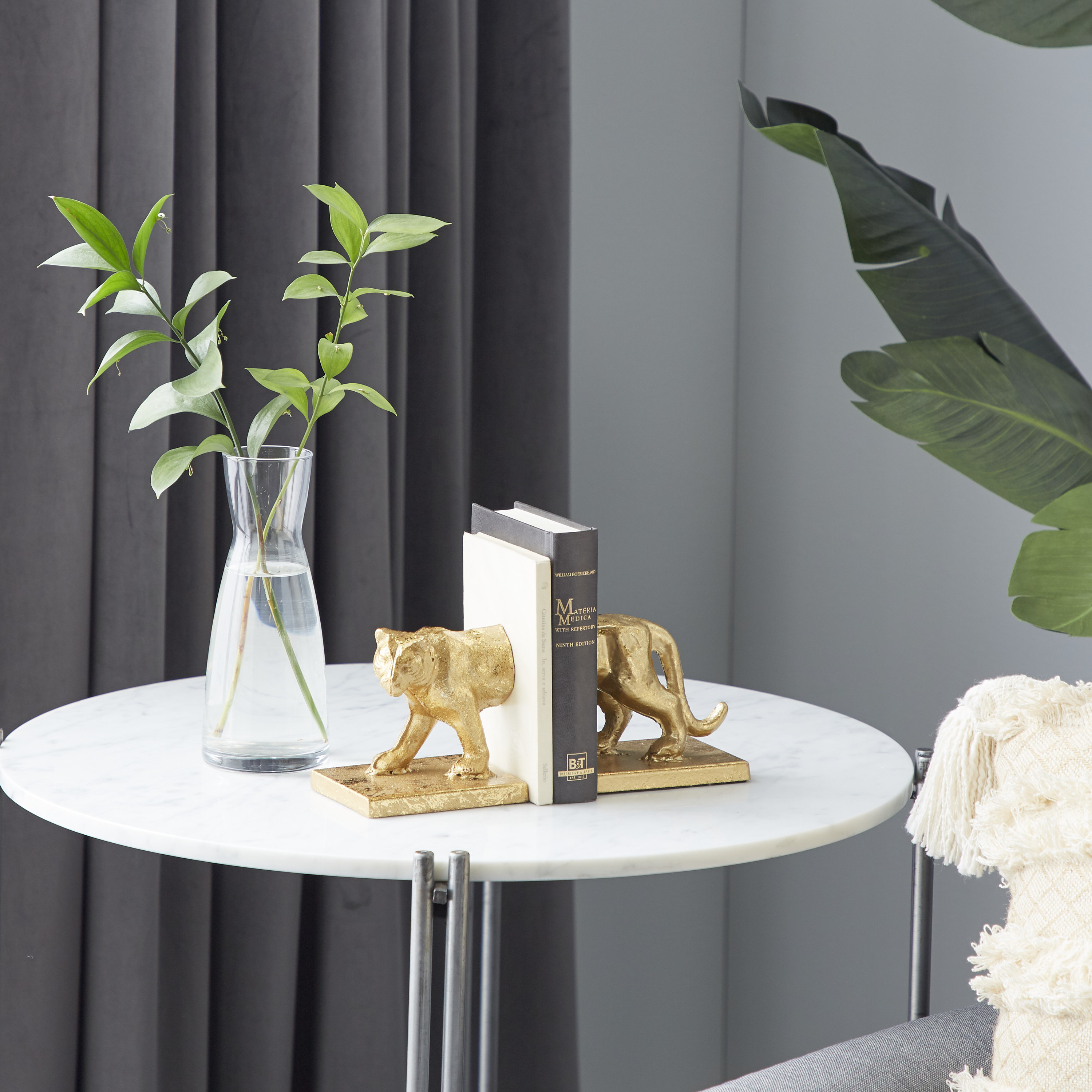 A set of gold bookends on a table