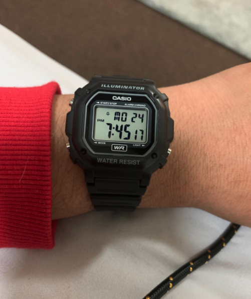 reviewer wearing the Casio watch on their wrist