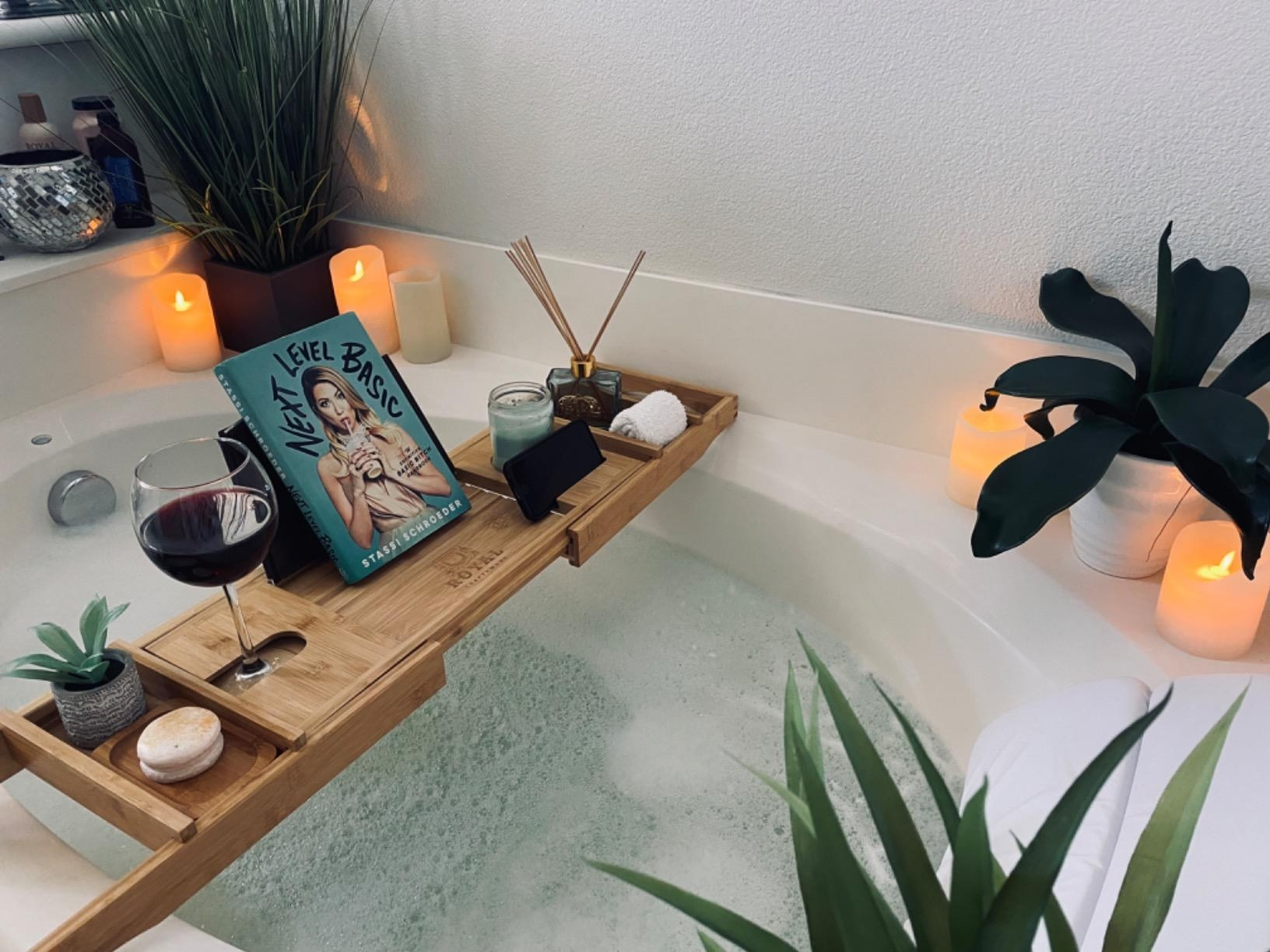 The tray placed on tub with relaxing items on top
