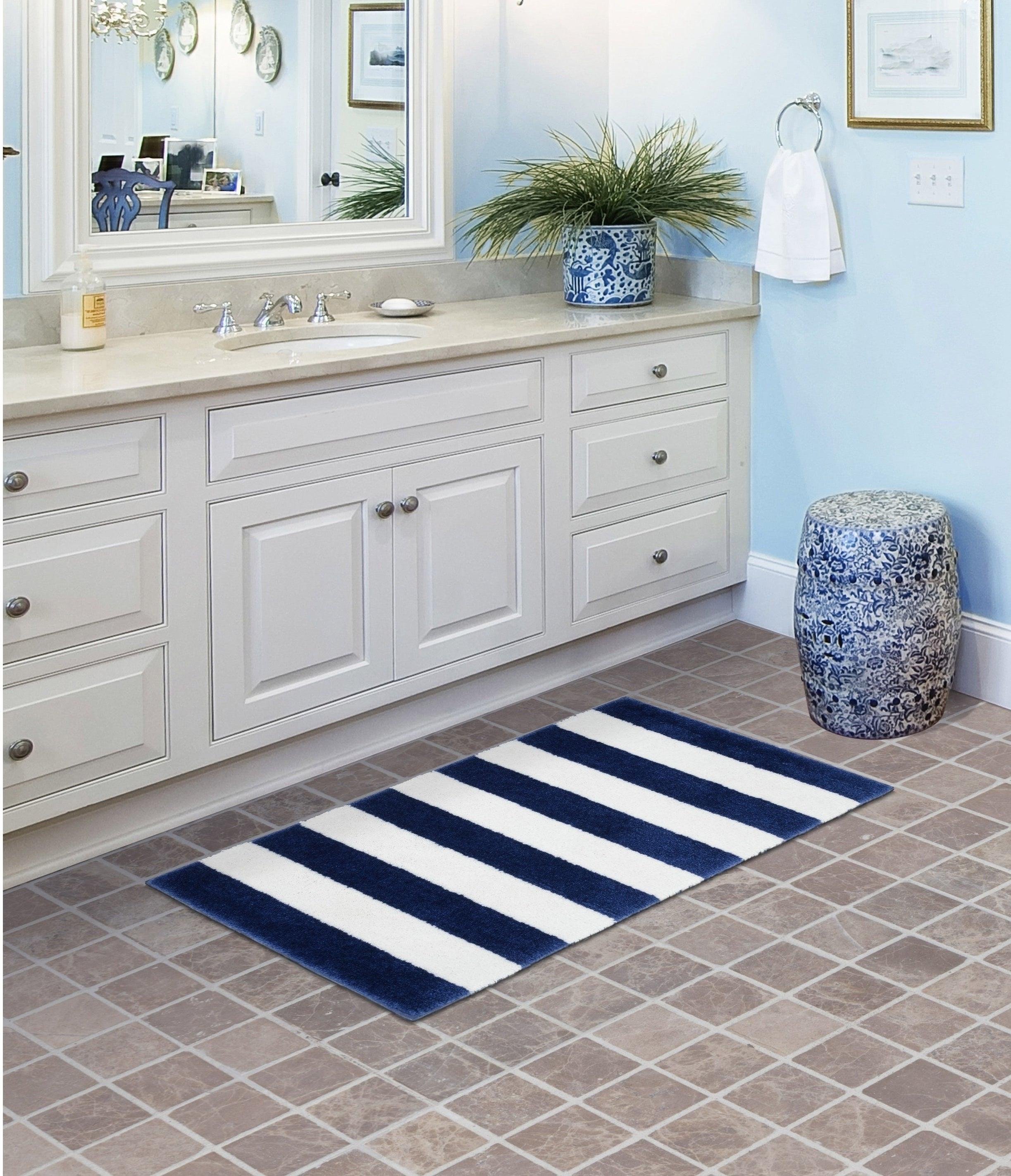 A striped bathroom mat on the floor