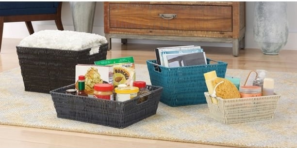 A brown, grey, blue and white basket being used in a home