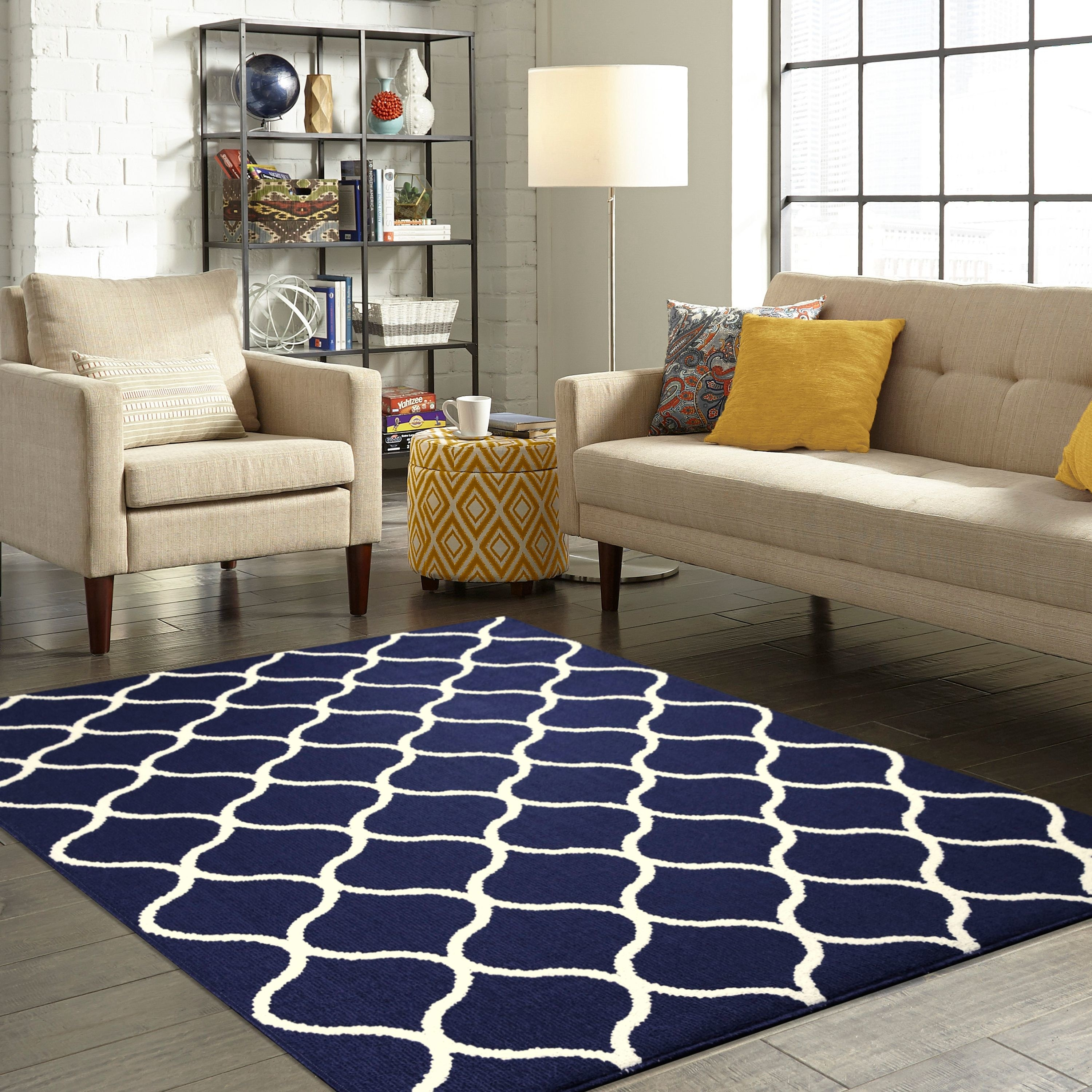 A blue rug with white detailing in a home