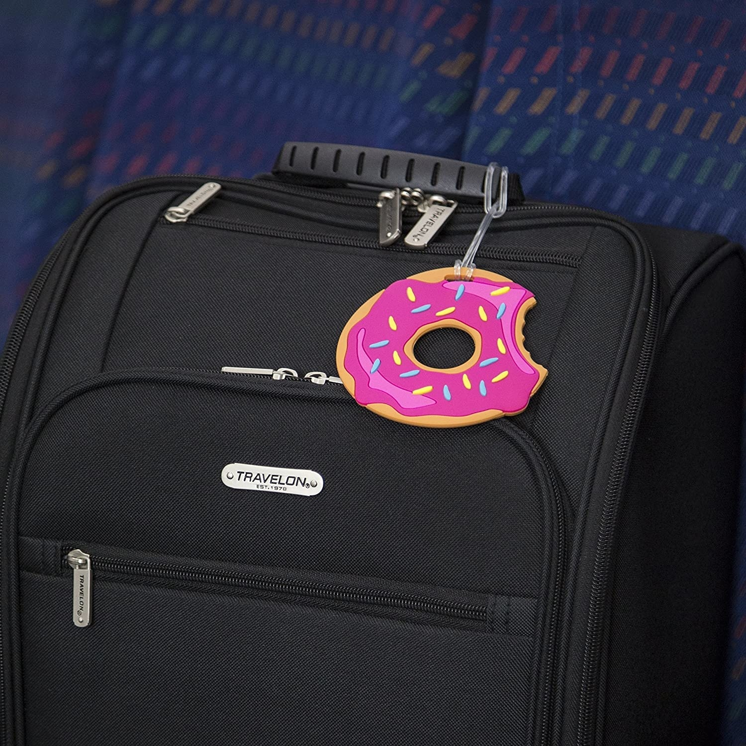 A donut tag attached to a suitcase
