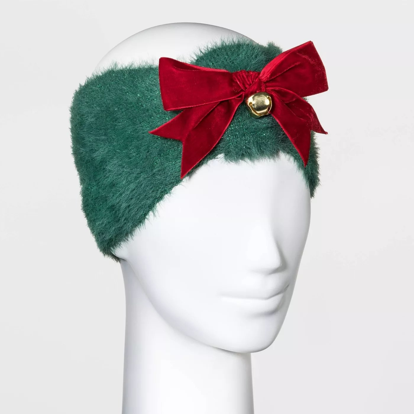 Green headband with red bow. Jingle bell also hanging from the bow.