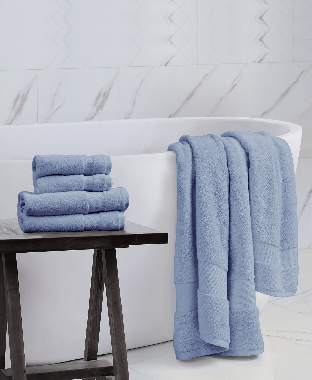 the blue charisma american heritage towel set in a bathroom