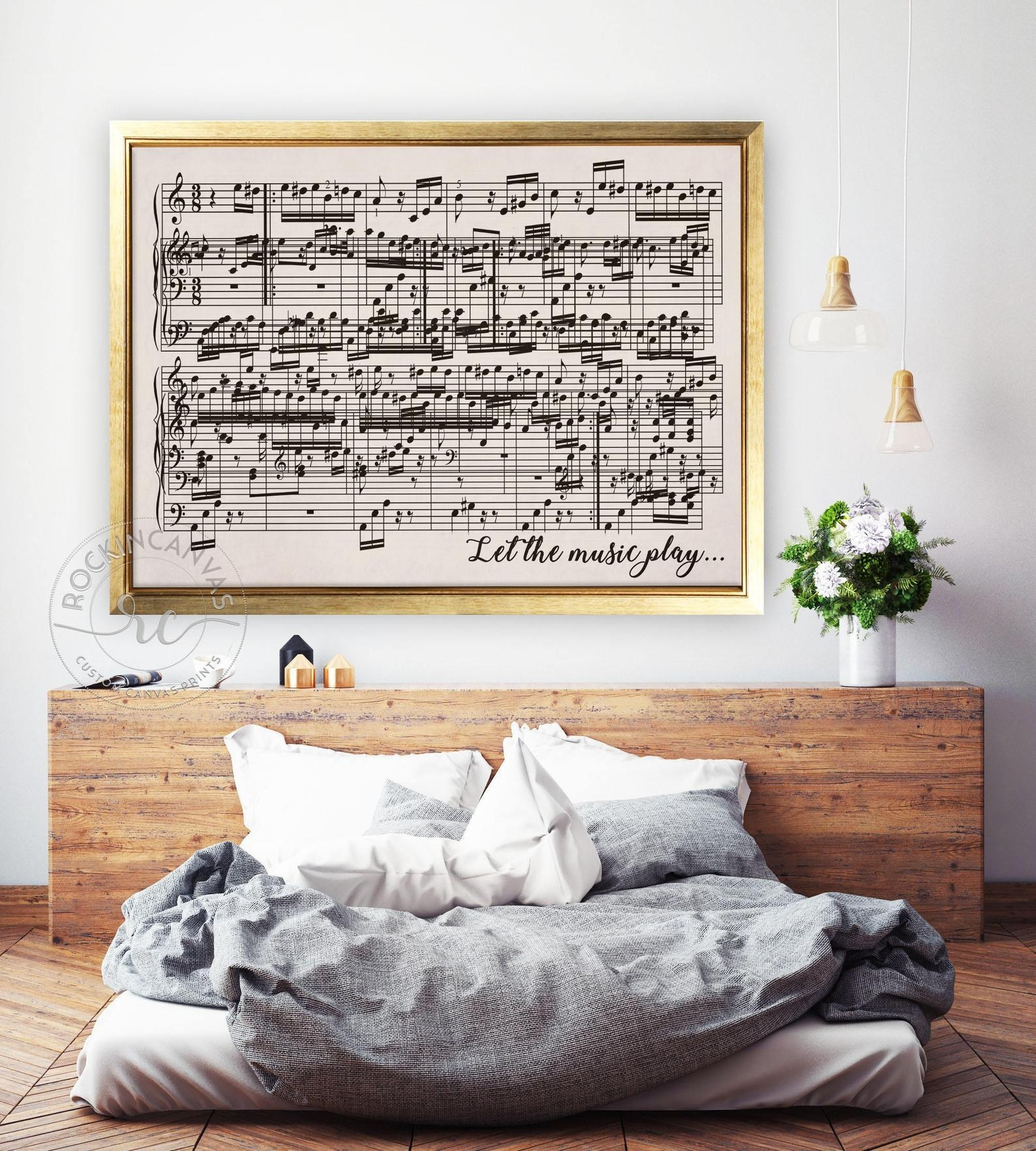 """Music sheet canvas print in a gold frame that says """"Let the music play"""""""