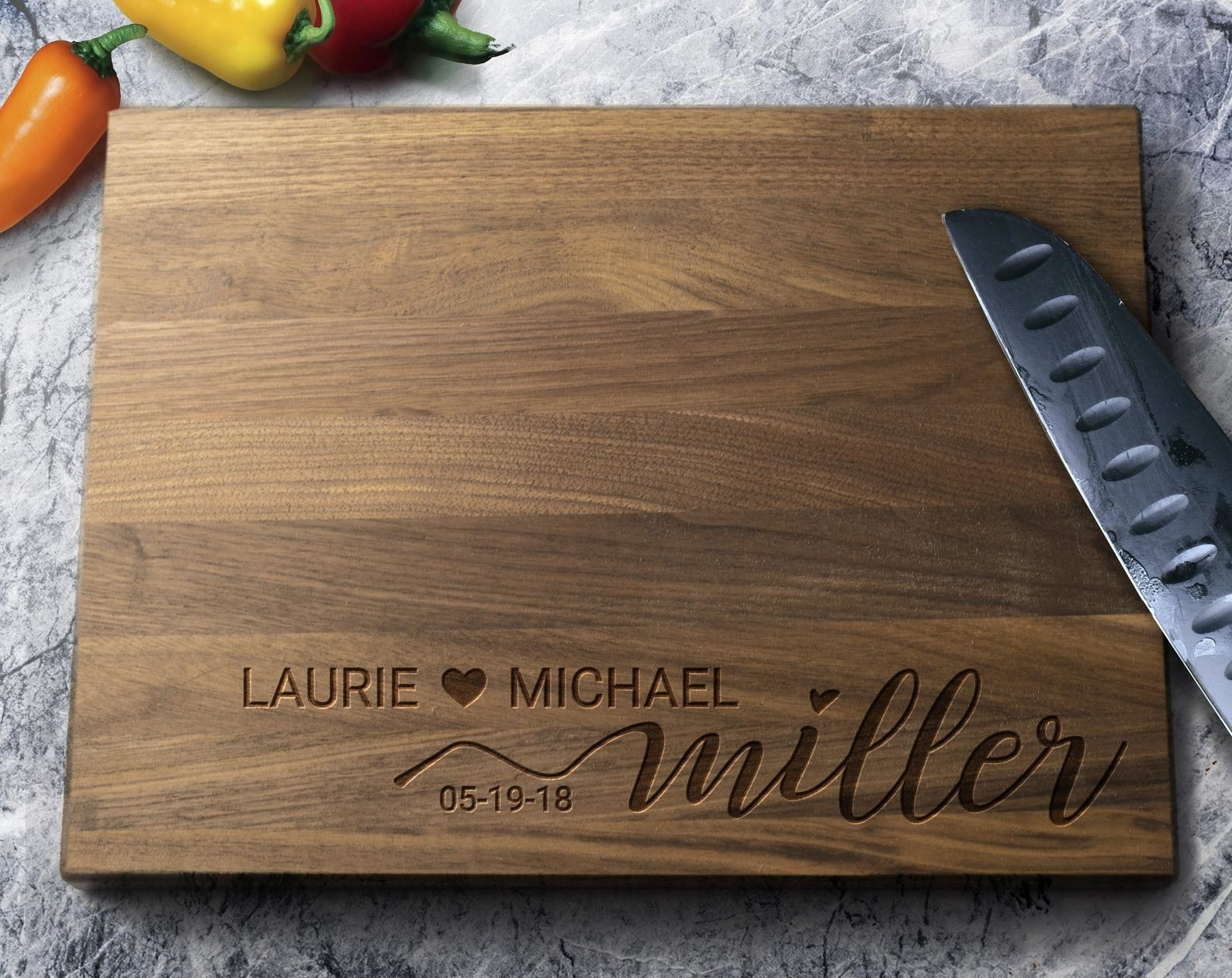 the cutting board with Laurie and Michael Miller, 5-19-18 engraved into it