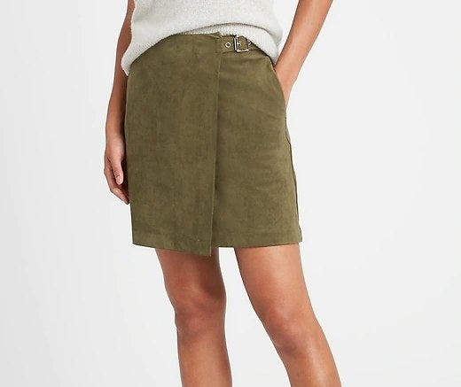 Model wearing the skirt in color Find Your Adventure Green