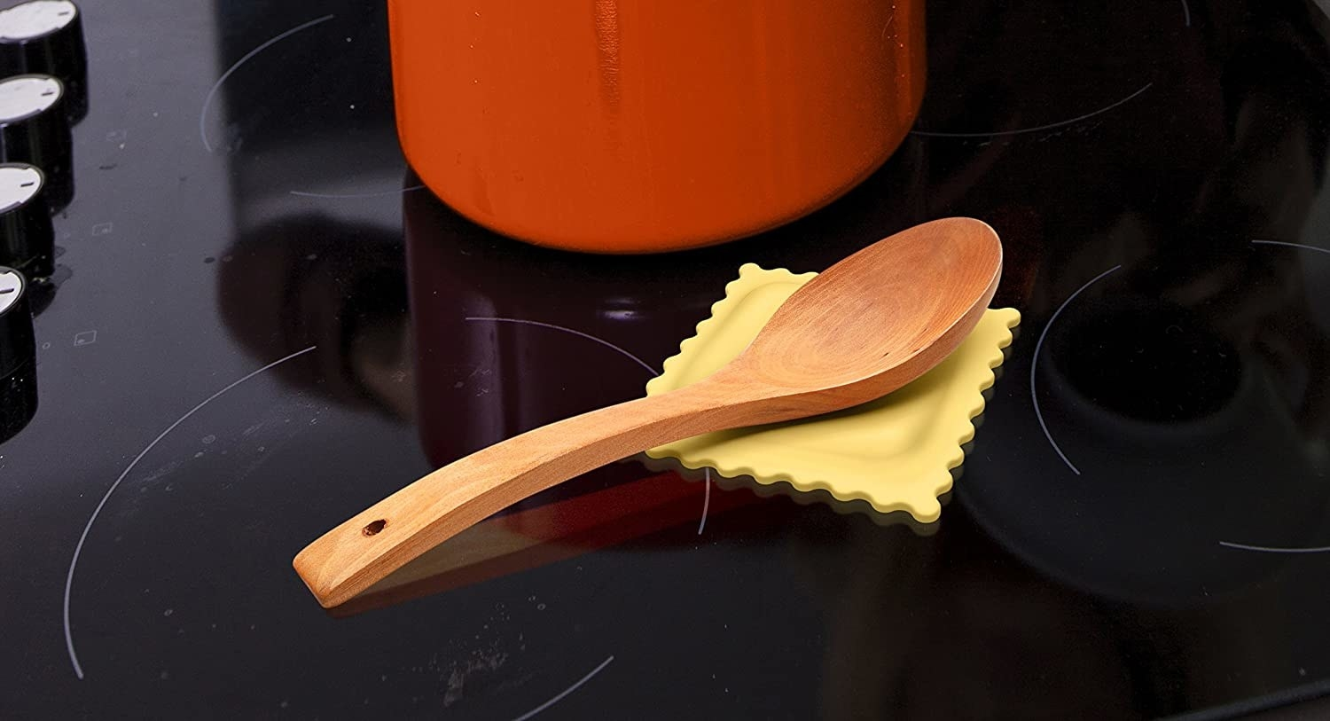 wooden spoon on the spoon holder on an oven top