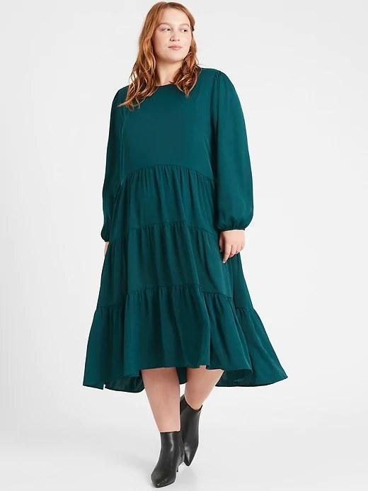 Model wearing the dress in color Glen Green