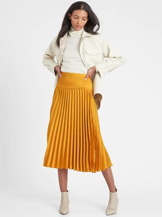 Model wearing the skirt in color Golden Yellow