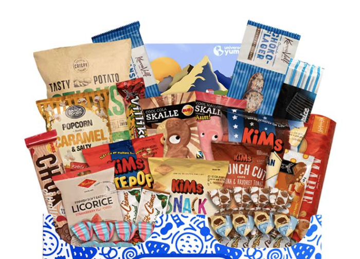 An assortment of packaged snacks peeks out from a blue and white designed box