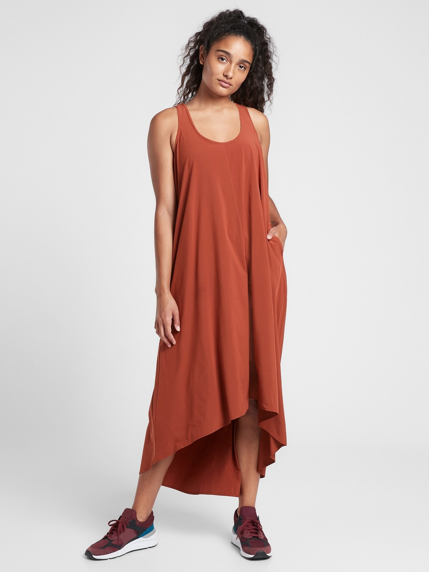 A model wearing the dress in Russet Brown