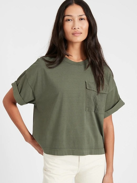 Model wearing the T-shirt in color Dark Olive Green