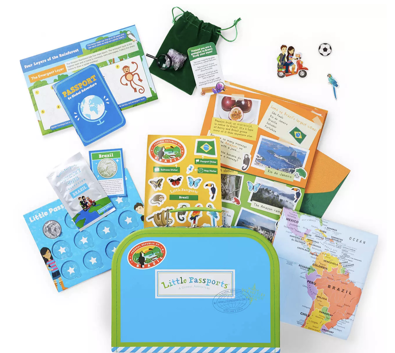 An array of colorful items against a white backdrop, including a mini suitcase, map, stickers, and fake passport