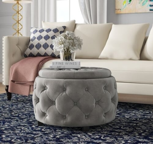 Round, gray, velvet tufted ottoman with removable top for storage