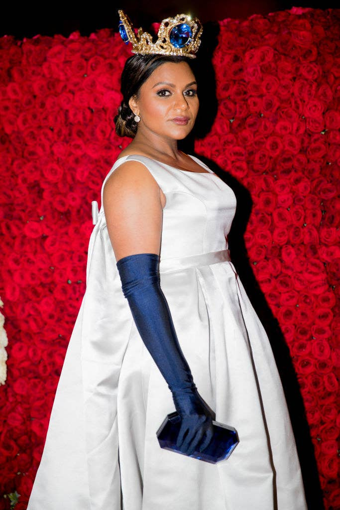 Mindy wearing a large crown and light dress