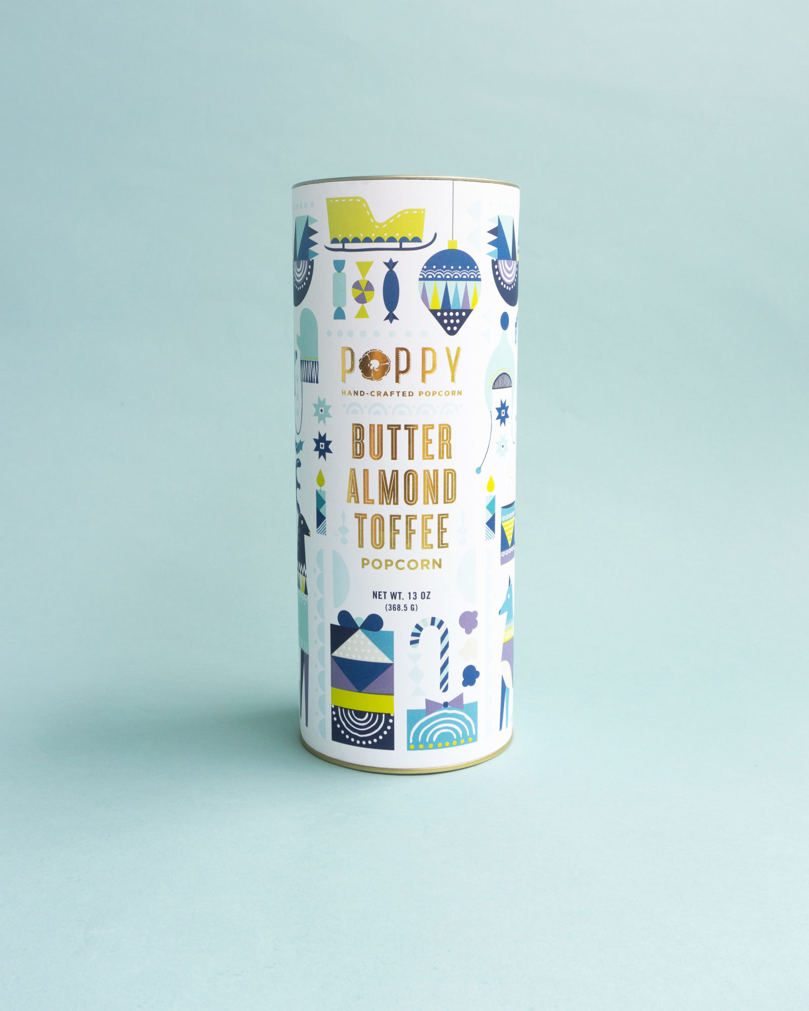 white tin with blue and yellow holiday designs
