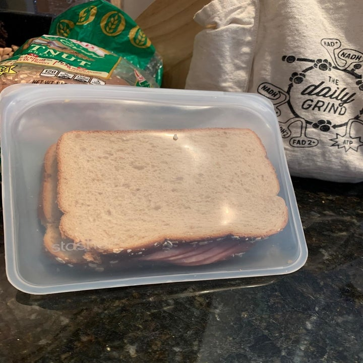 A reviewer photo of a sandwich in a clear silicone storage bag