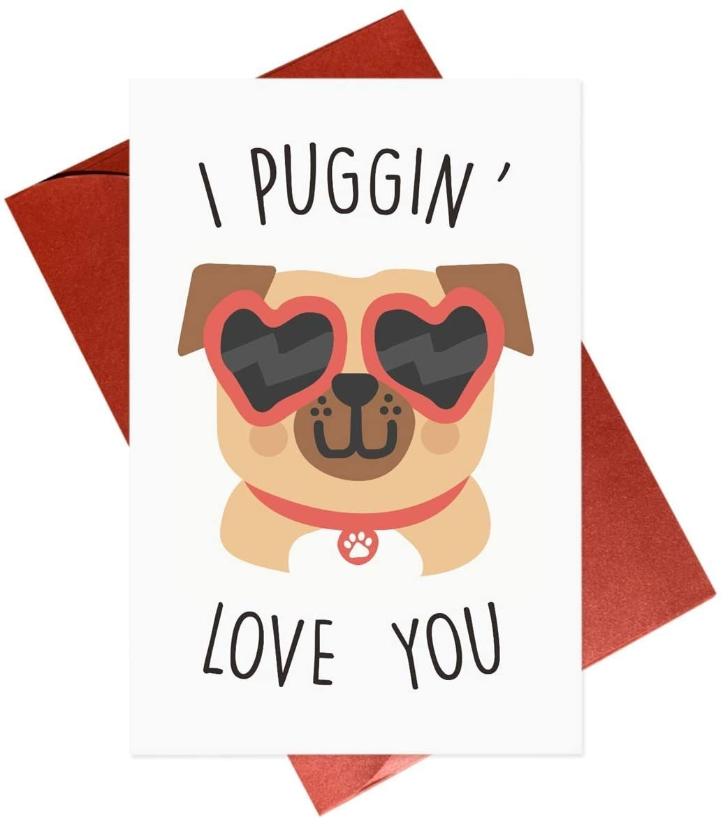 """A white card with a cartoon of a pug wearing heart-shaped sunglasses, that says """"I puggin' love you"""" in black type"""