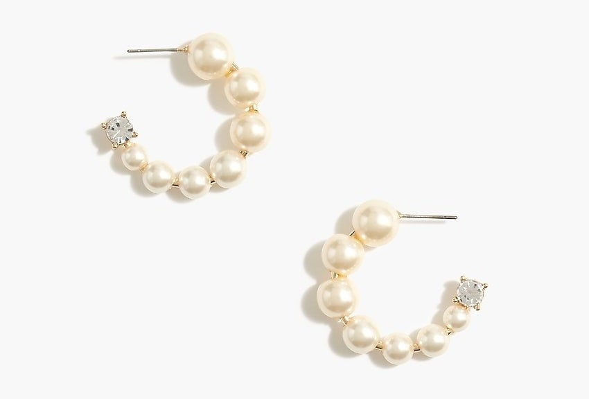 The open hoops in graduated pearls with a rhinestone at the end of each