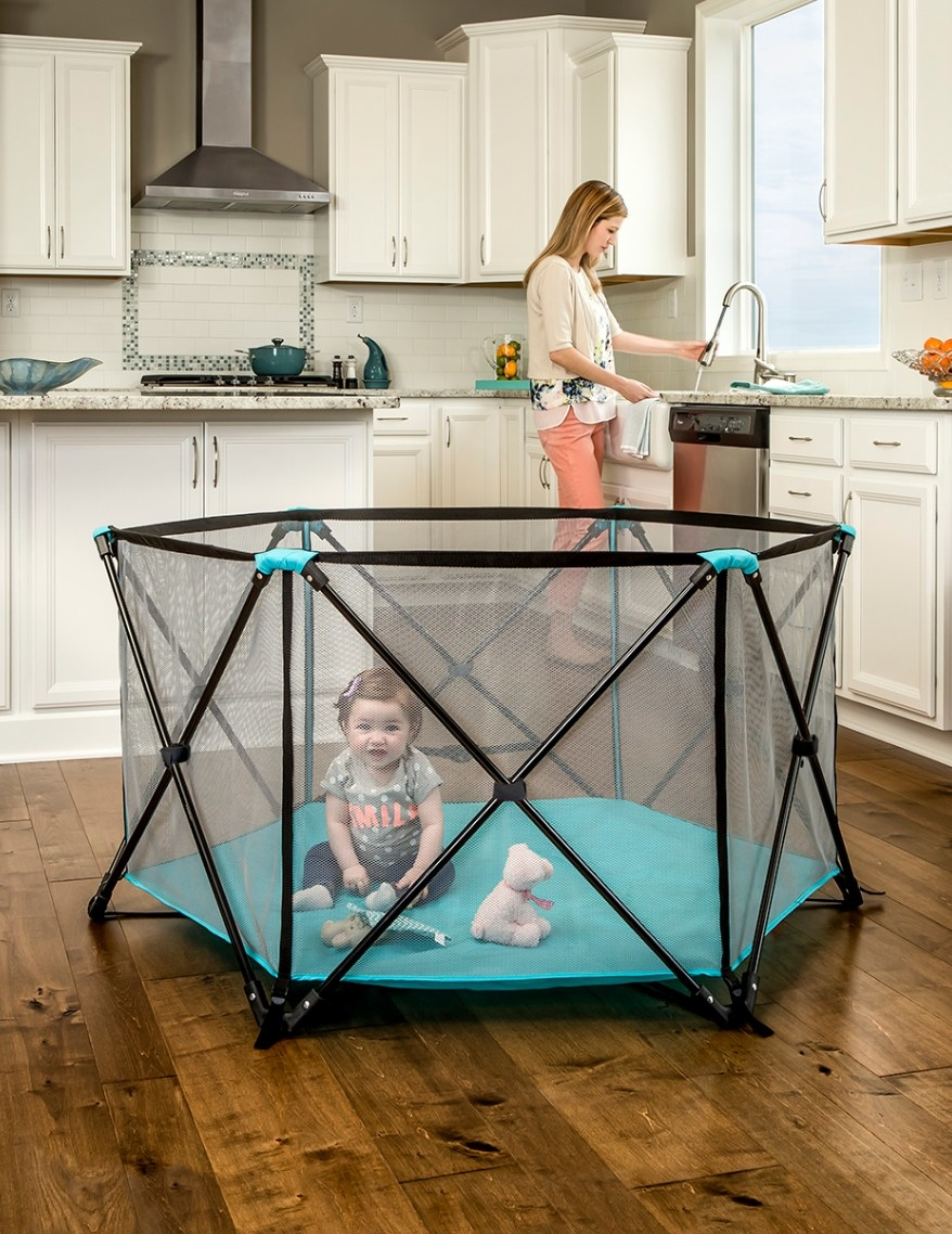 The portable play yard in black and blue