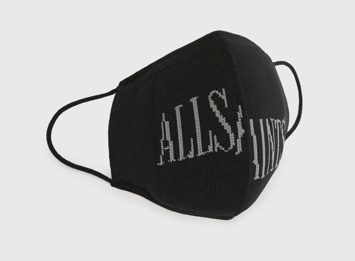 a black face mask with allsaints stitched across it