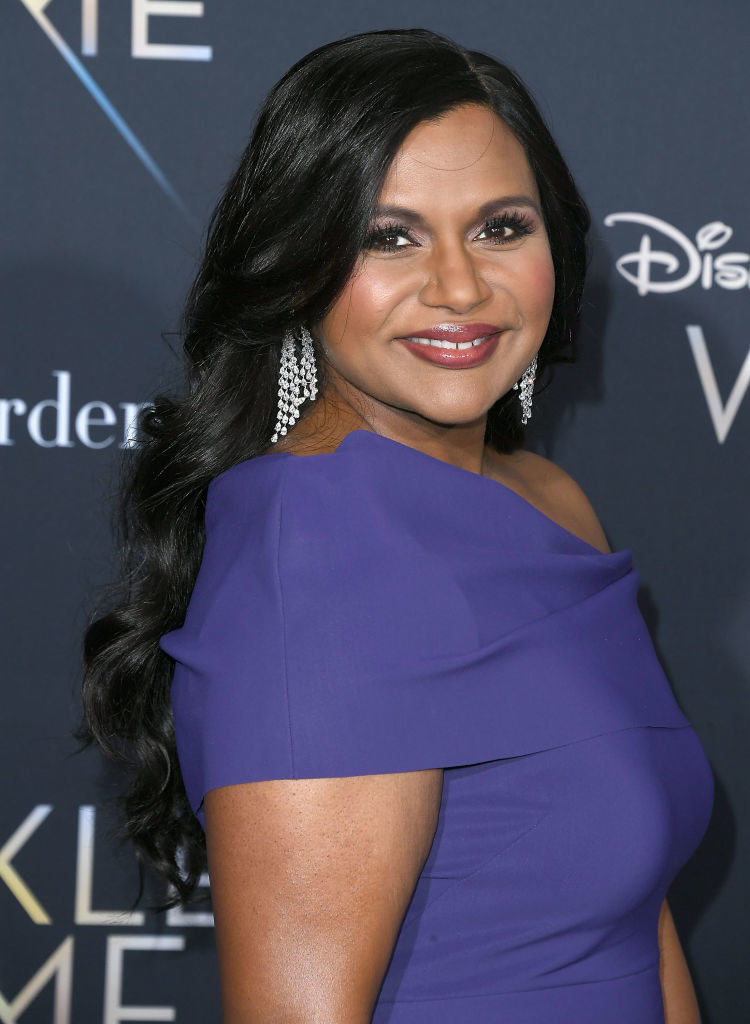 Mindy smiling with dangling earrings