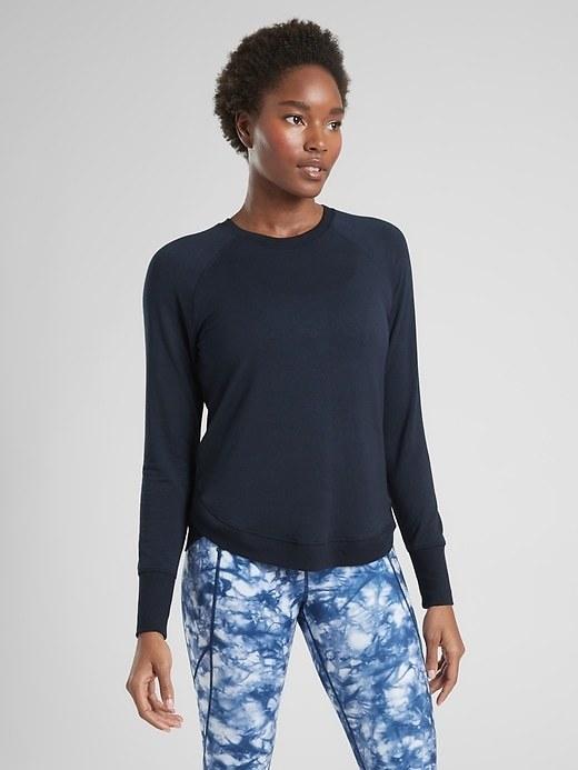 A model wearing the sweatshirt in navy