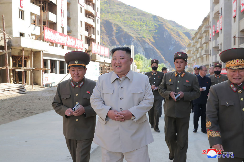 Photo of Kim Jong Un touring a construction site with his military officials
