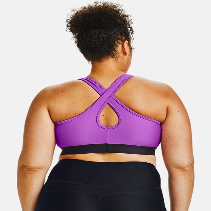 the same model showing the cross-back of the bra in purple