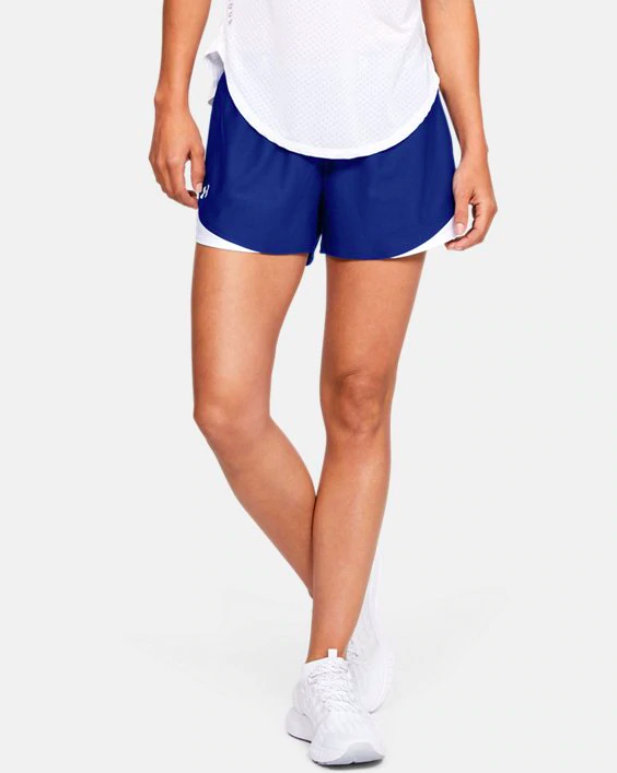 a model wearing the shorts in blue