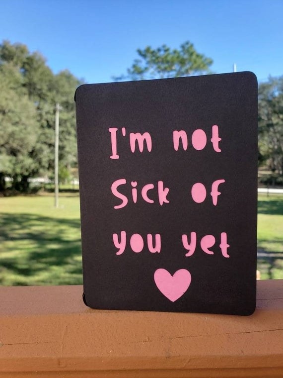 """A black card with pink cut-out reading """"I'm not sick of you yet"""""""