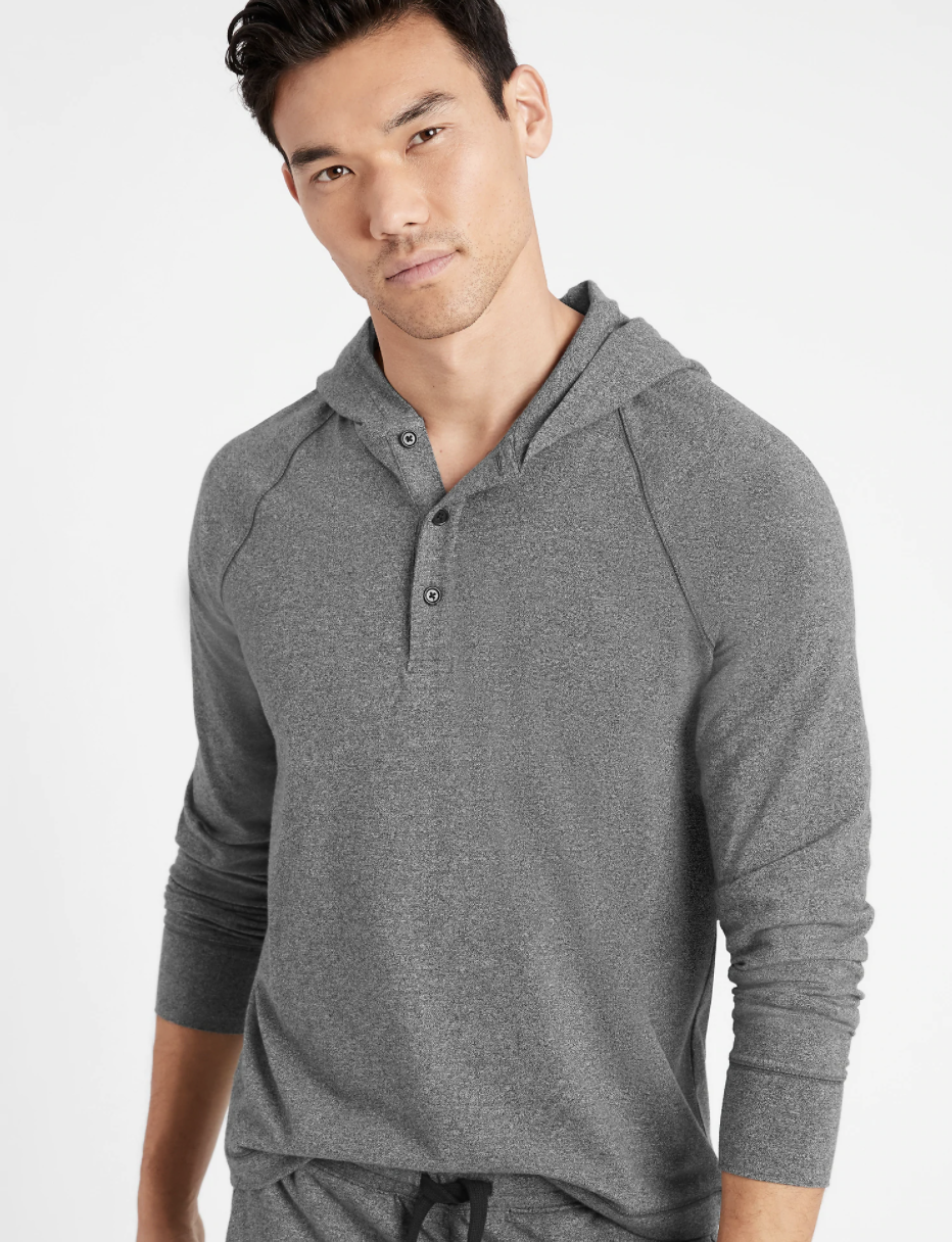 Model wearing henley hoodie in the shade charcoal gray
