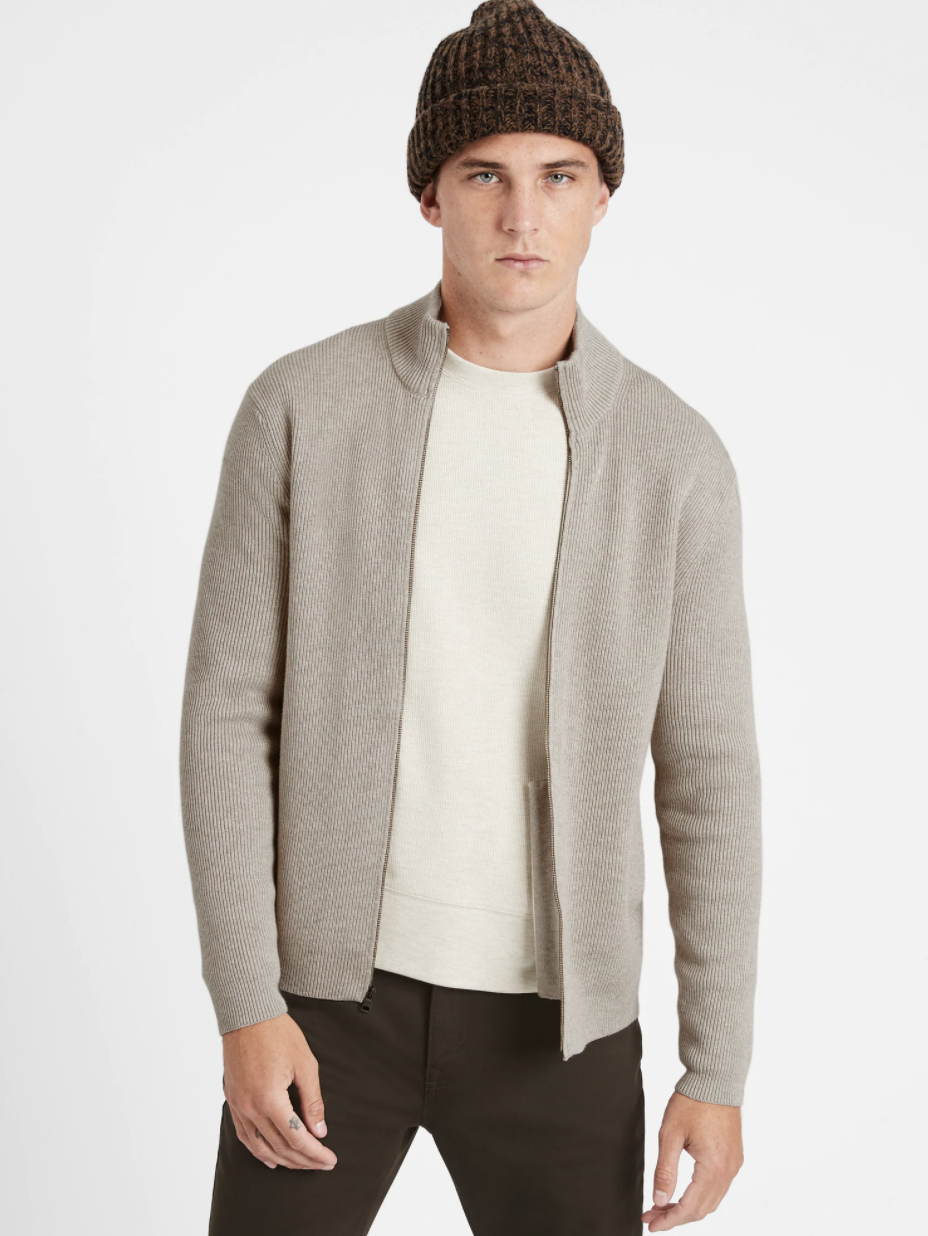 Model wearing Supima cotton sweater jacket in the shade stone gray