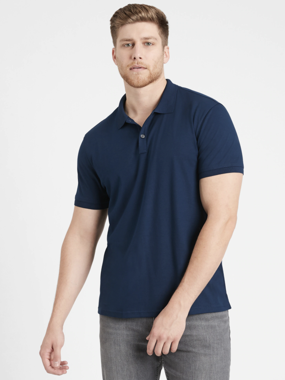 Model wearing slim luxury-touch polo in the shade navy